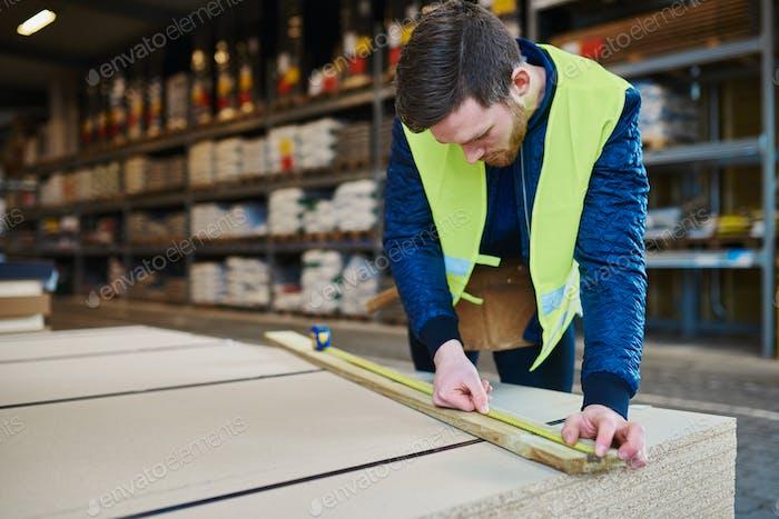 Handyman working in warehouse