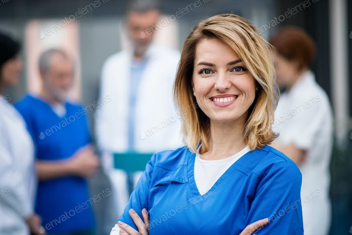 Portrait of doctor standing in hospital on medical conference