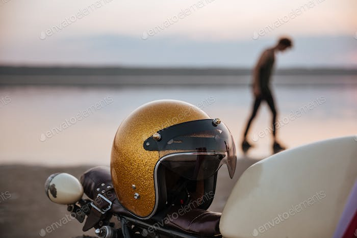 Close up of motorcycle with american flag and golden helmet