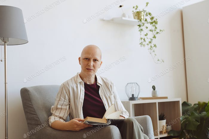 Modern Bald Woman Reading at Home