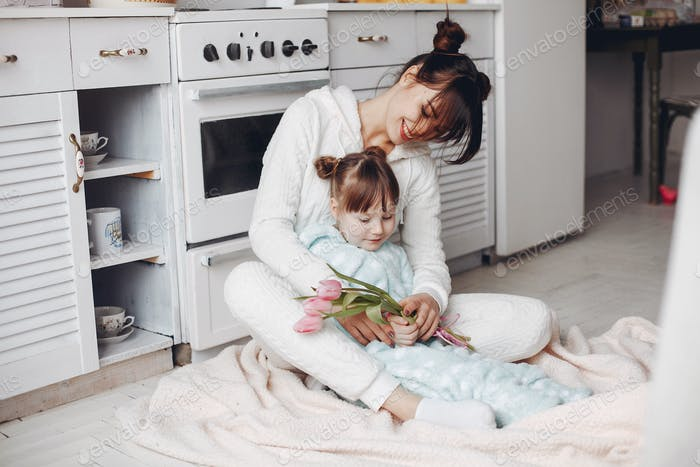 Mother with little child at home