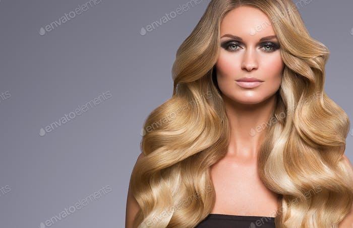 Blond woman long hair curly natural fashion makeup