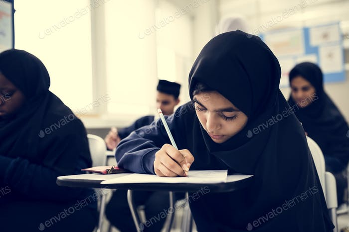 Muslim children studying in classroom