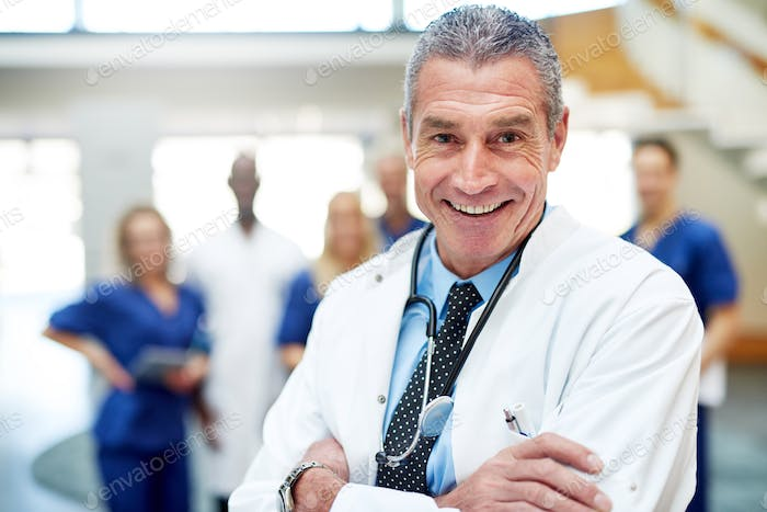Medical specialist smiling standing with arms crossed