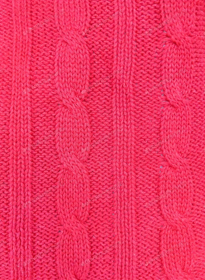 Pink knitted texture background. Pattern of wool knitting for wallpaper and an abstract background