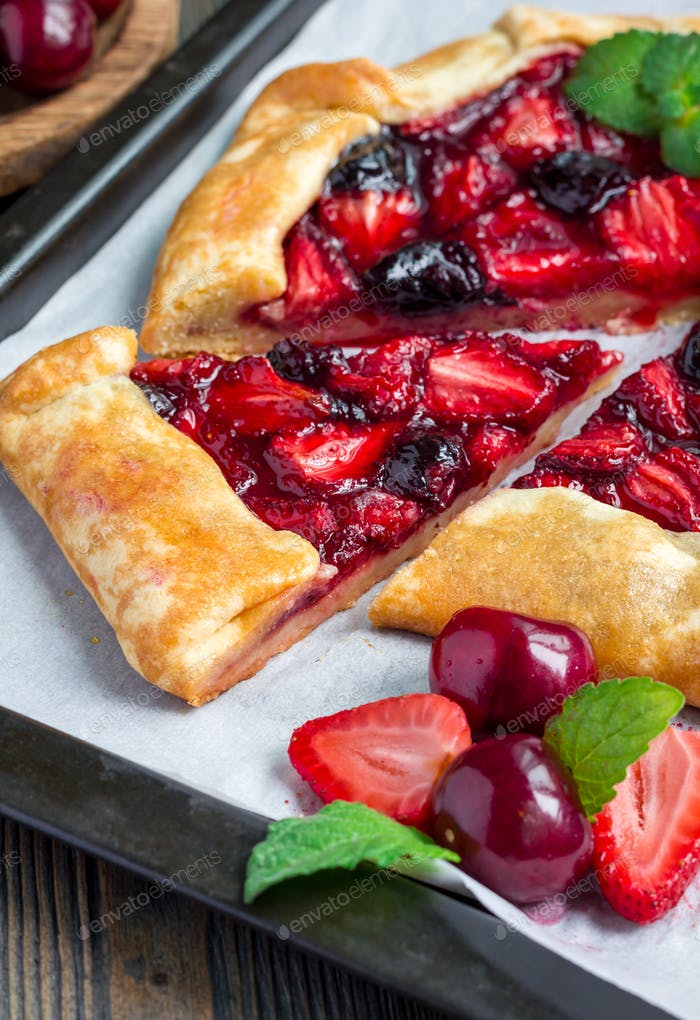 Cottage cheese dough galette with strawberry and cherry, vertical