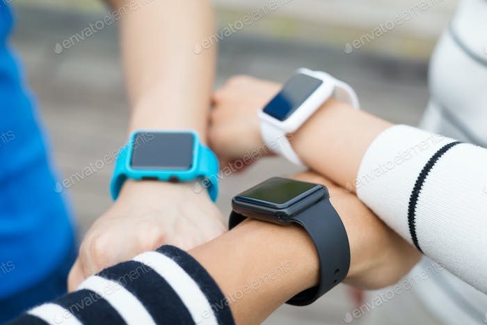 Group of people wearing smartwatch
