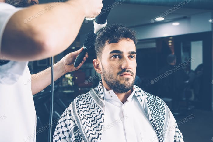 Man being dried in salon