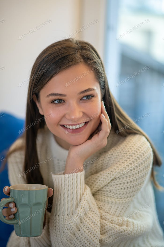 Portrait of a cheerful beautiful young woman