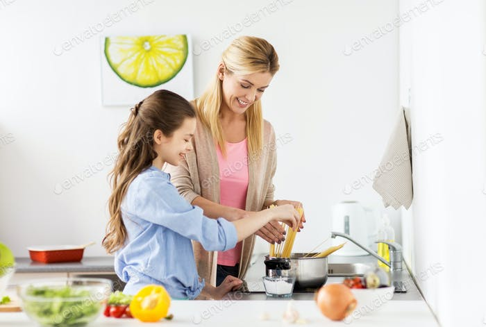 happy family cooking food at home kitchen