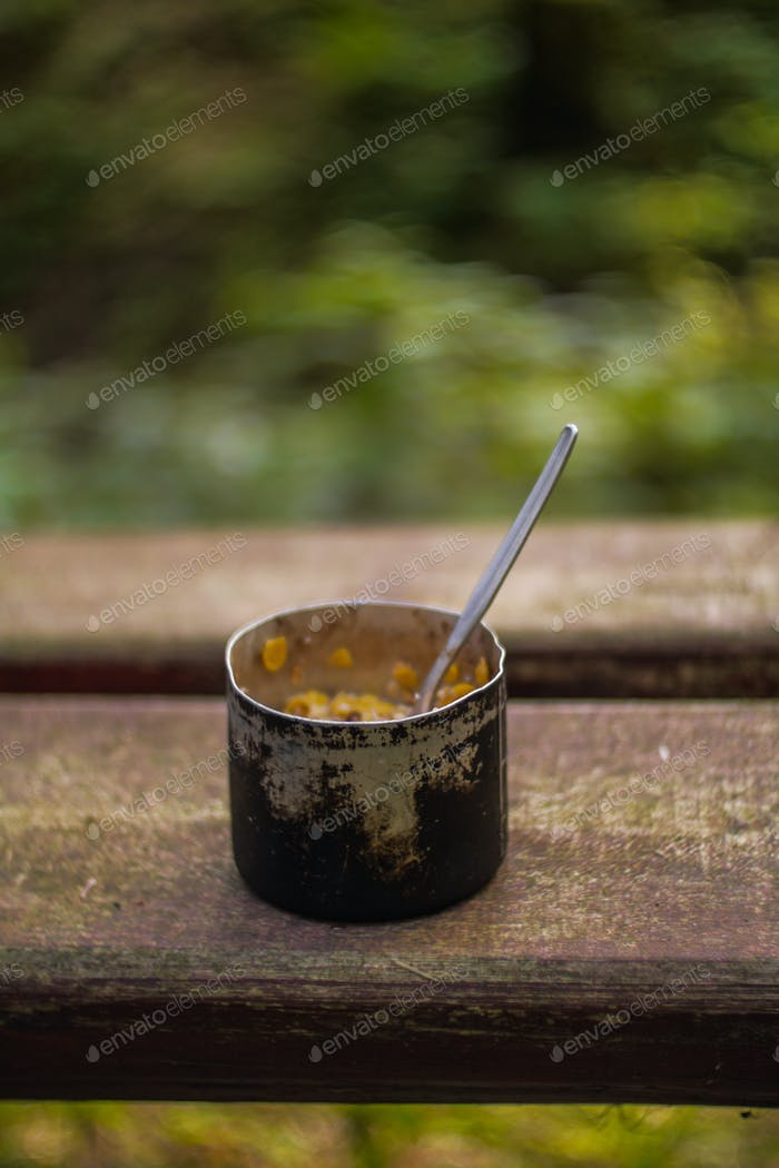 aluminium mug with camping food breakfast