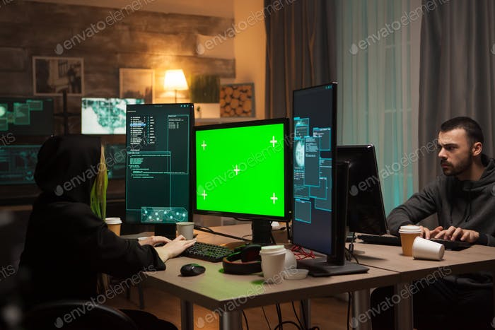Female hacker writing a malicious virus against a firewall