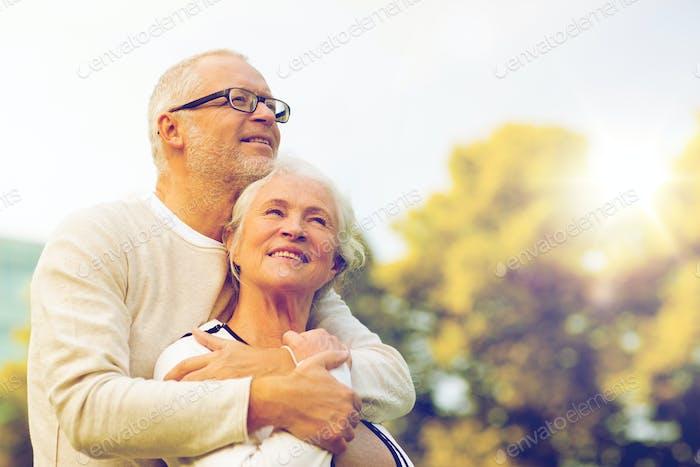 senior couple hugging in park