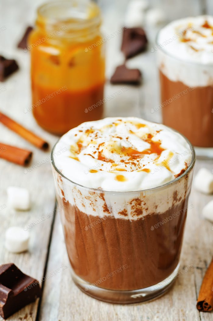 hot dark chocolate with whipped cream, cinnamon and salted caram