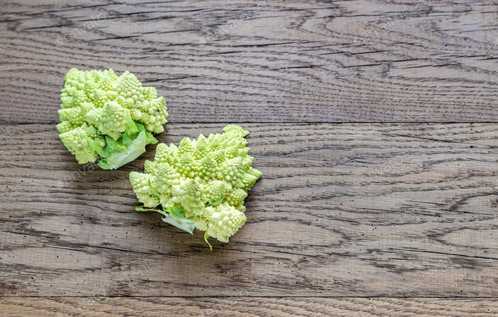 Fresh romanesco broccoli on the wooden board