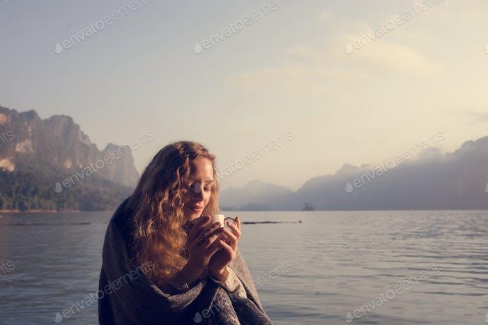 Woman warm in the morning sun