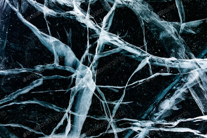 Cracked ice close up. Patterns of winter Baikal