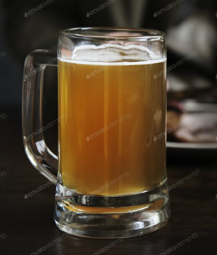 A glass of beer on the table