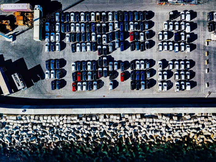 Aerial view of used cars lined up in the port