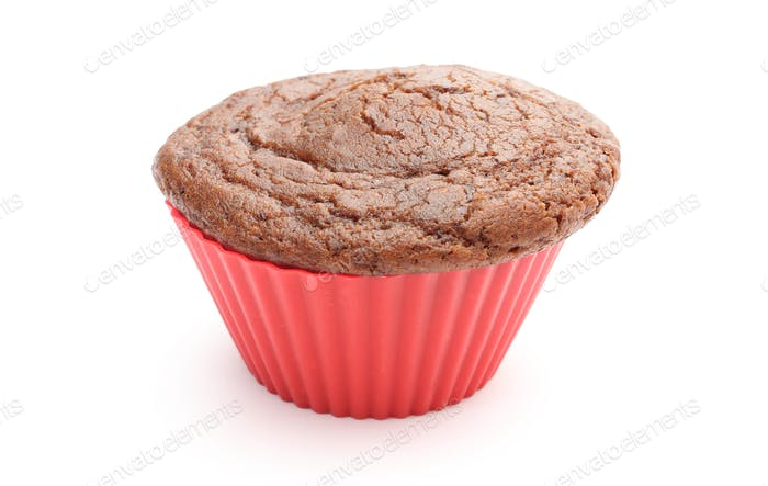 Fresh baked chocolate muffin in red silicone cup