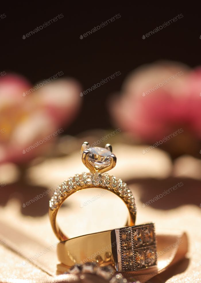 Close-up view of the diamond golden engagement rings