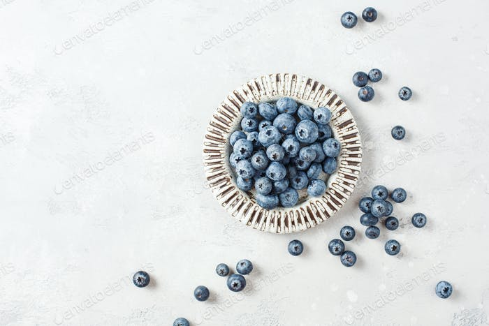 Fresh blueberries on a small ceramic plate