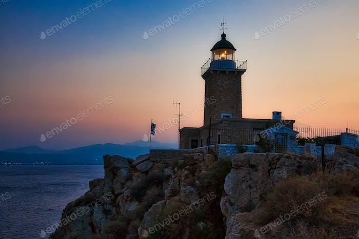 Lighthouse on the coast on sunset, Greece coastline