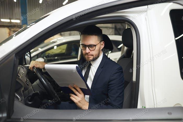 Serious Man In Car