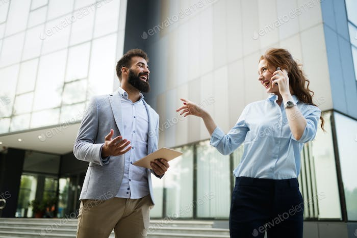 Business people or businessman and businesswoman working outdoor