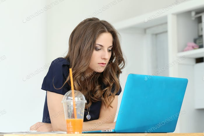 Curly girl with laptop