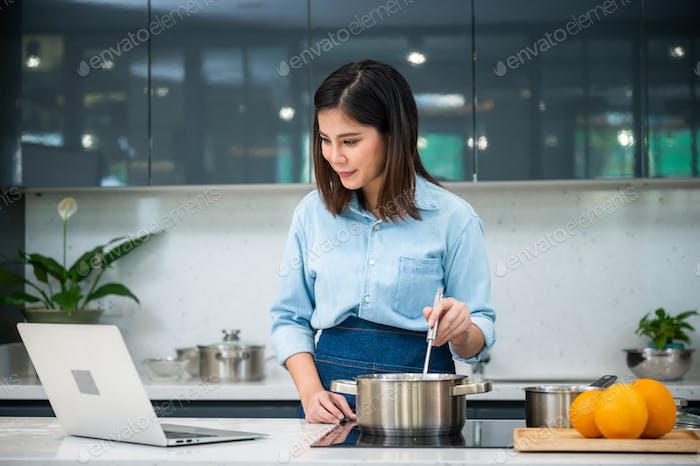 cooking study at home via internet, Happy asian person try to learn for cooking