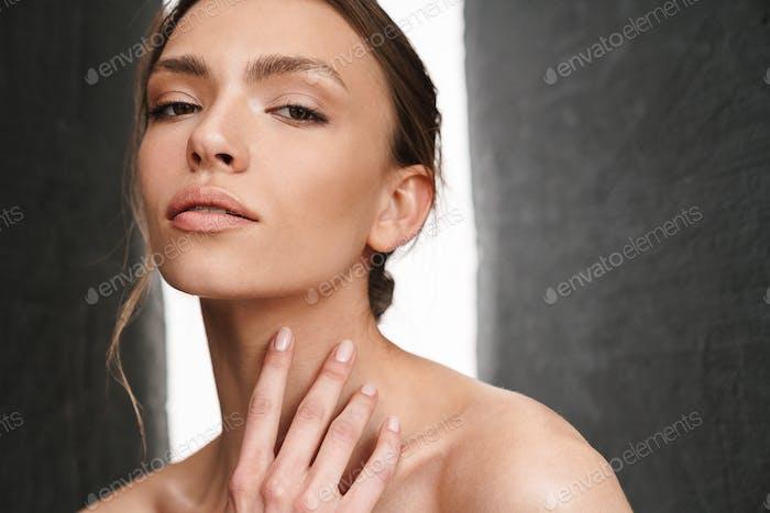 Image of beautiful caucasian young brunette shirtless woman
