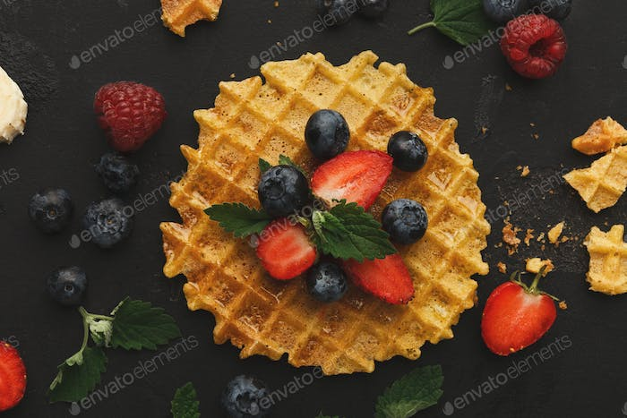 Round waffles with fruits, breakfast background