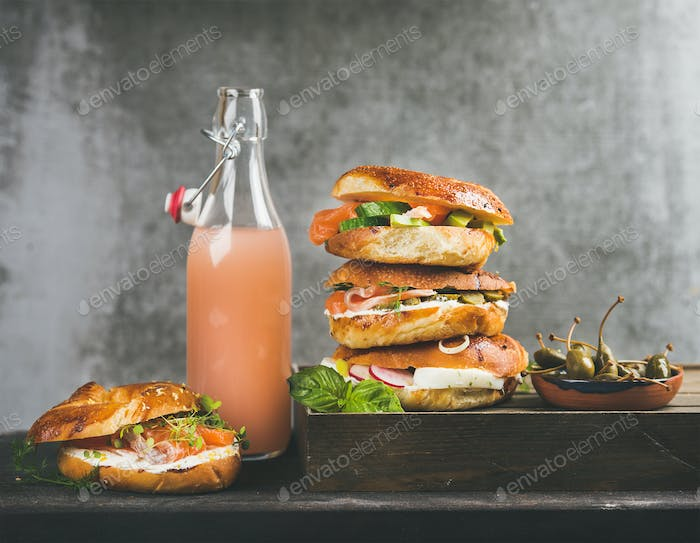 Bagels with salmon, eggs, vegetables, capers, cream-cheese and grapefruit lemonade