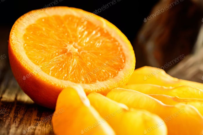 Ripe juicy fresh oranges, whole, cut and slices