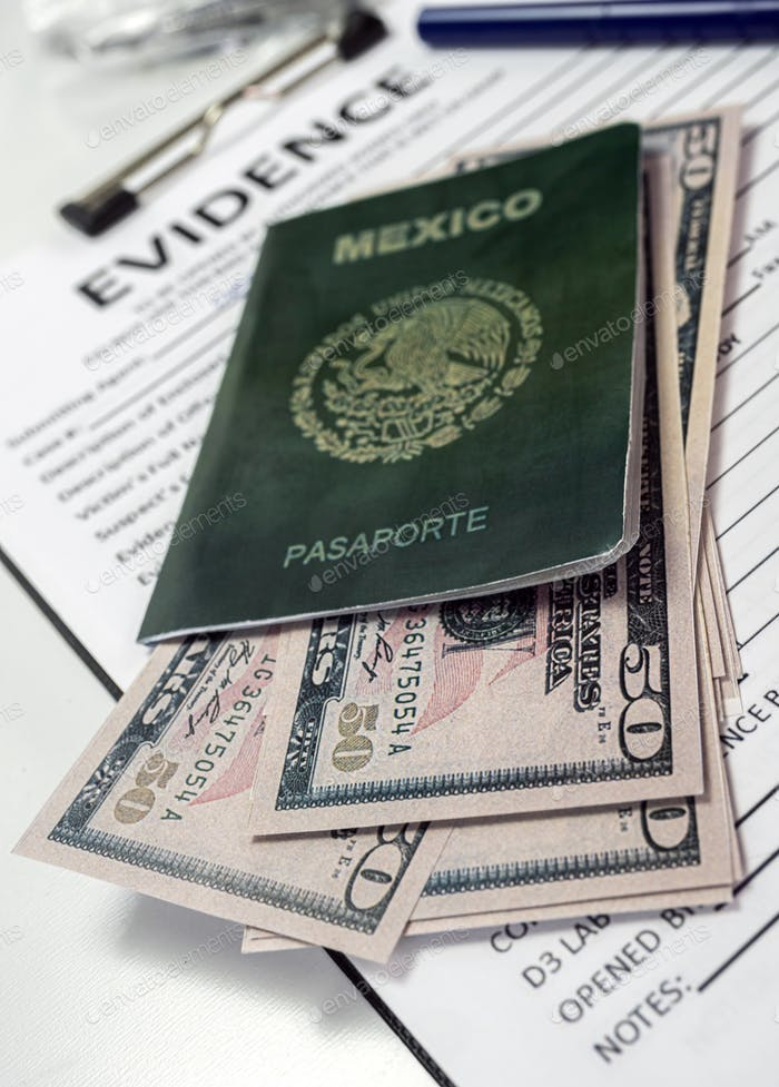 Some fifty-dollar notes in a Mexican passport in a crime lab, concept image