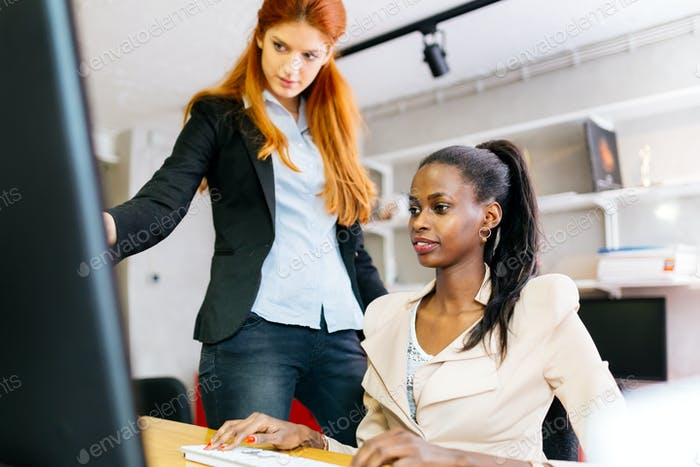 Busiensswoman advising colleague