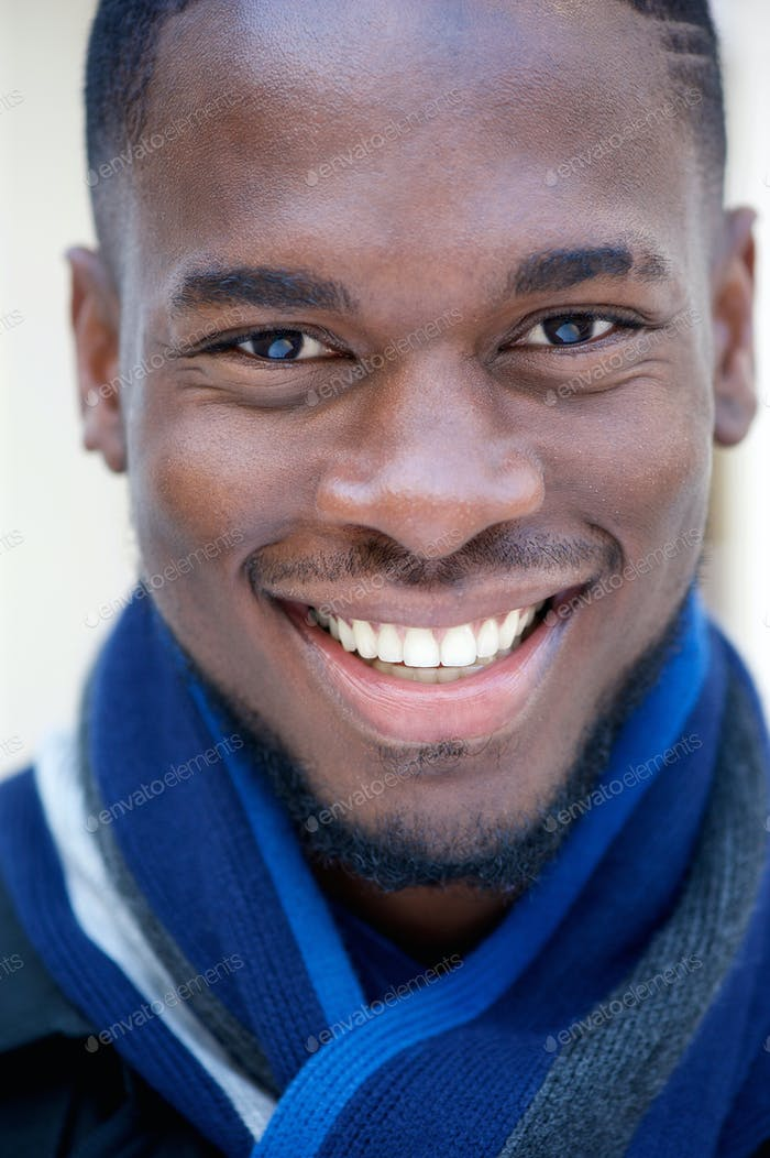 Happy young black man smiling