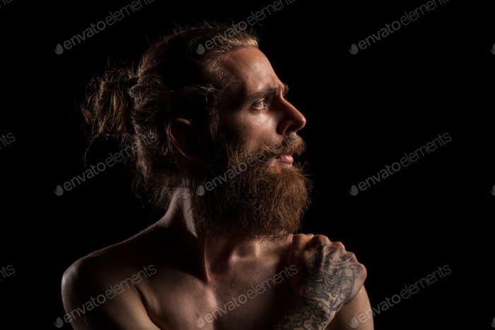 Cool bearded hipster on black background