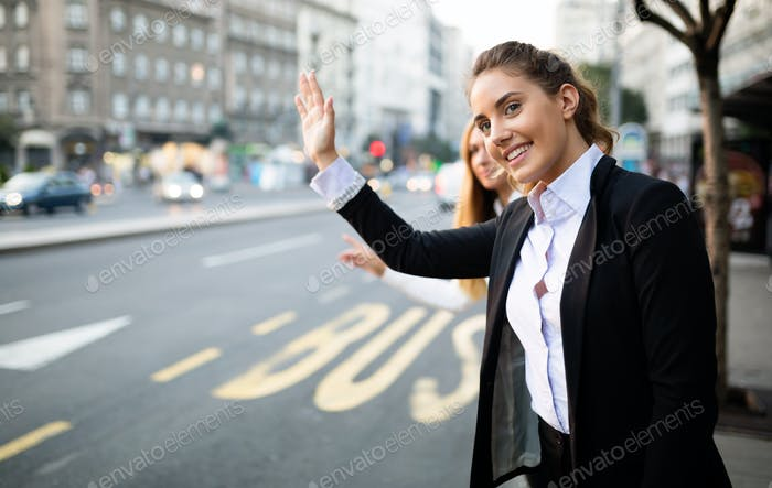 Business women hailing cab