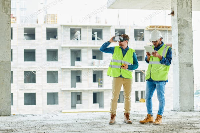 Two Workers Using VR on Site