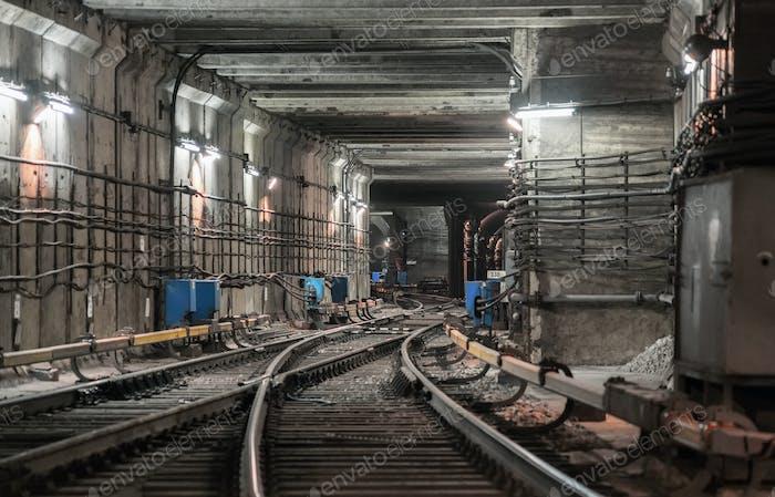Railway arrow in the underground tunnel of the metro