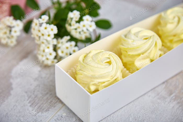 Gift box with homemade lemon yellow color marshmallows.