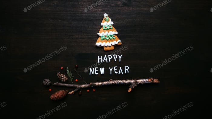 Happy New Year text with gingerbread Christmas tree