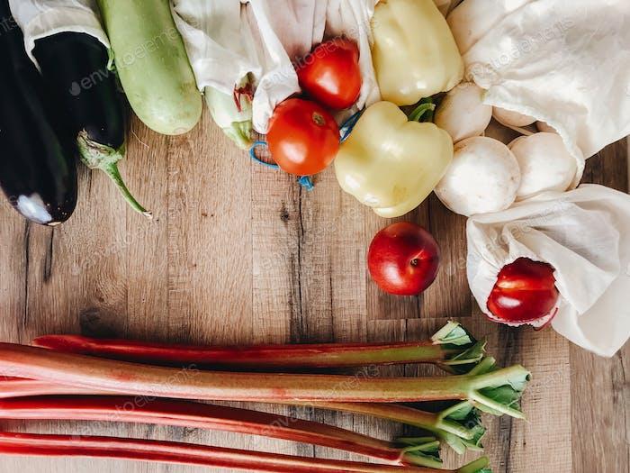 Mushrooms, zucchini,eggplant, pepper, tomato, nectarines on wooden background