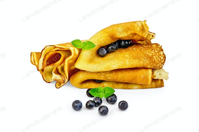 Pancakes with blueberries and mint