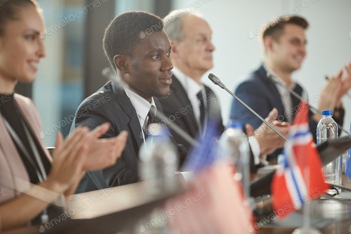 African man clapping at conference