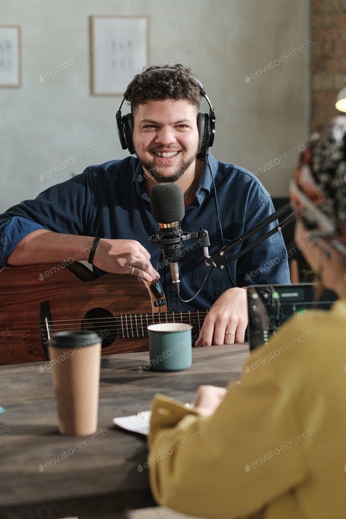 Musician with guitar on the radio