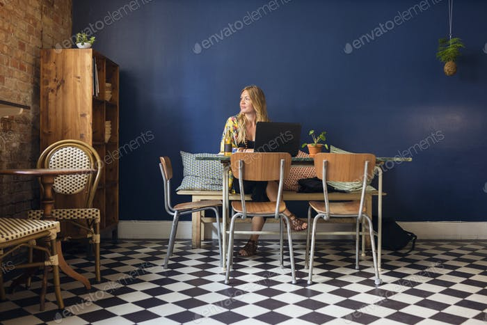 Woman sitting in bakery