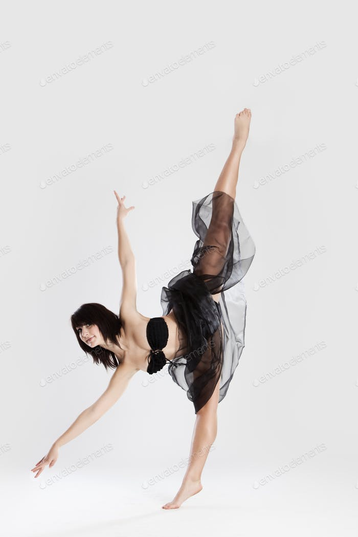 Beautiful female ballerina doing split